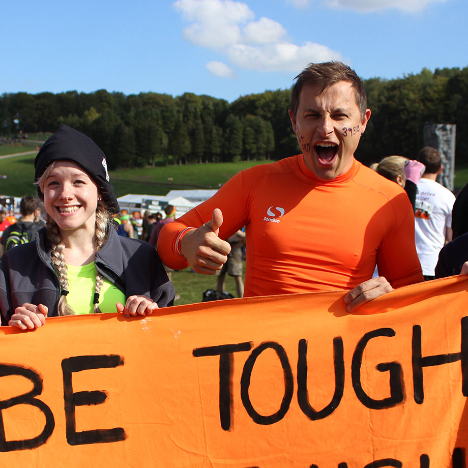 Tough Mudder, man with thumbs up