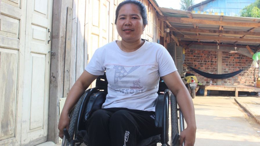 A female wheelchair user smiling at camera