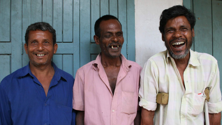 Three male activists smiling to camera