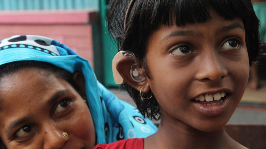 a hearing impaired girl with her mother