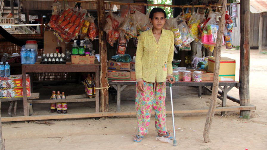 a woman with a physical impairment outside her stall