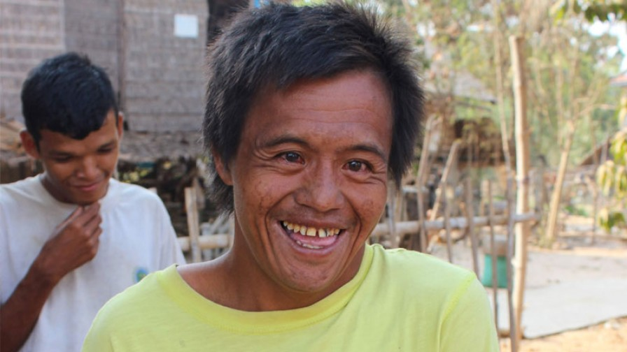 a man with an intellectual disability smiling to camera