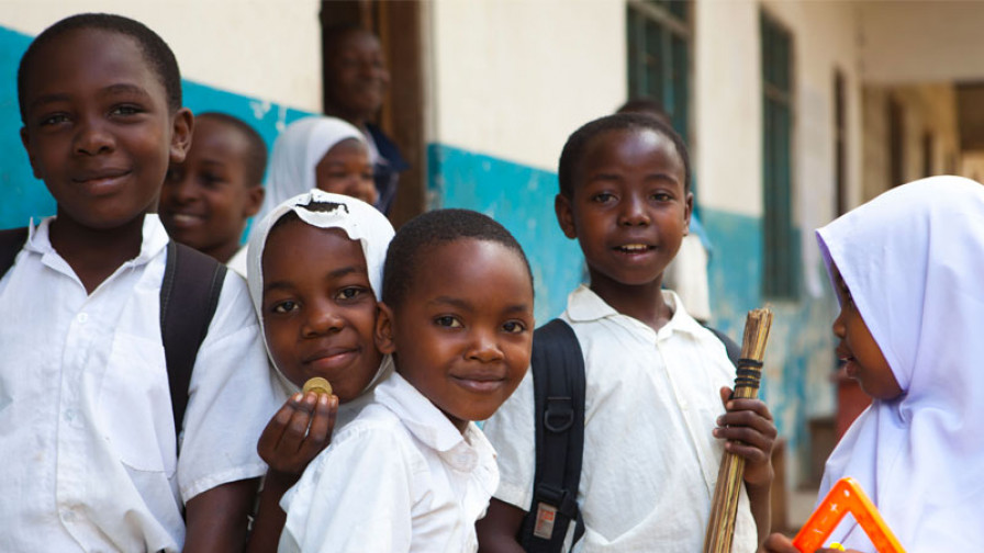 a group of kids outside their classroom