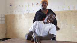 A student and his teacher in Tanzania