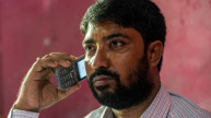 Shamim on the phone in his office in Bogura, Bangladesh