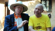 Peter talking with another man with albinism