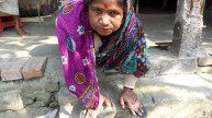 Pushpa outside her house