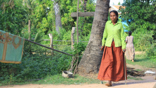 A Cambodian farmer in her field