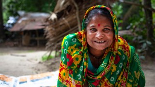 A disability activist in Bangladesh smiling to camera
