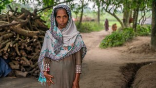 A woman outside her home in Bangladesh