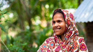 Side profile of a lady in Bangladesh smiling