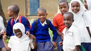 Children smiling in the playground, Tanzania