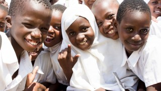 A group of smiling children in Tanzania