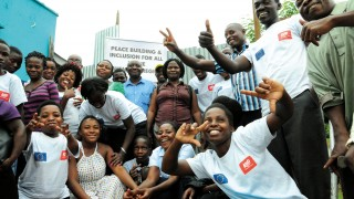 A group of disability activists in Uganda smiling to camera