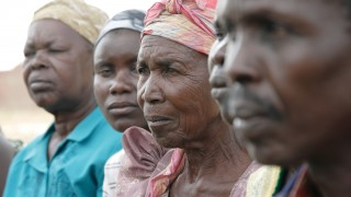 Close up of the faces of a line of women in Uganda