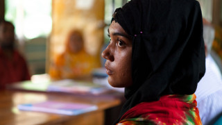 a disability activist in Bangladesh, listening in a meeting