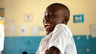 A smiling student in an inclusive school in Tanzania