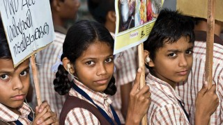 Bangladesh Children protesting disability rights with placards